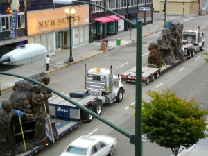 """Remember them"" statues on trucks"